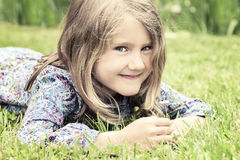 Adorable girl lying on grass Royalty Free Stock Image