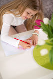 Adorable girl making gift card for mother day Stock Photos