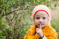 Adorable girl making silence sign Royalty Free Stock Images