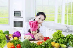 Adorable girl and mother cooking vegetables Royalty Free Stock Photo