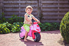 Adorable girl on motorcycle Royalty Free Stock Photos