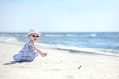 Free Adorable Girl On A Sunny Sand Beach Royalty Free Stock Photography - 14750897