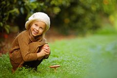 Free Adorable Girl On Meadow With Mushroom Stock Photos - 134425813