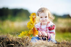 Adorable girl outdoors on beautiful autumn day Stock Photo