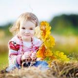 Adorable girl outdoors on beautiful autumn day Stock Photos