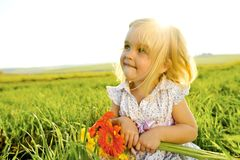 Adorable Girl outside with flowers Stock Images