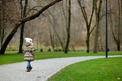 Adorable girl in a park Stock Photos
