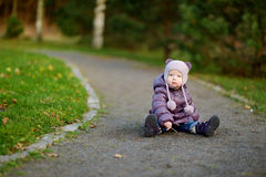 Adorable girl in a park Stock Images
