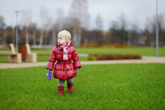 Adorable girl in a park Stock Image
