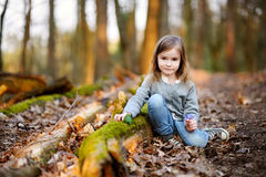 Adorable girl picking the first flowers of spring Royalty Free Stock Image