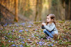Adorable girl picking the first flowers of spring Stock Images