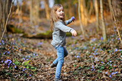 Adorable girl picking the first flowers of spring Stock Photos