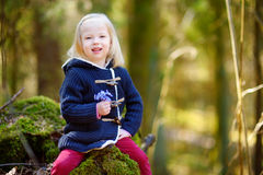 Adorable girl picking the first flowers of spring Royalty Free Stock Photos