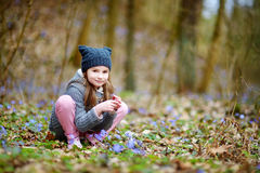 Adorable girl picking the first flowers of spring Stock Photo