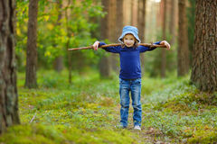 Adorable girl picking foxberries in the forest Royalty Free Stock Photography