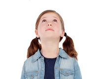 Adorable girl with pigtails looking up Stock Image
