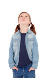 Adorable girl with pigtails looking up Stock Images