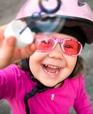 Adorable girl in pink safety helmet Stock Images
