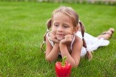Adorable girl with plate of vegetables in the garden Royalty Free Stock Photos