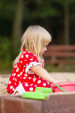 Adorable girl play with toys on sandbox Royalty Free Stock Photography
