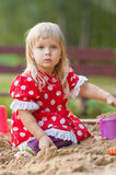 Adorable girl play with toys on sandbox Stock Photos