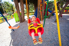 Adorable girl on a playground Royalty Free Stock Photo