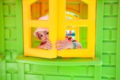 Adorable girl on a playground Royalty Free Stock Photos