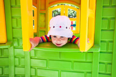 Adorable girl on a playground Royalty Free Stock Image