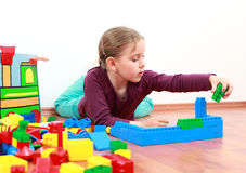 Adorable girl playing stock image