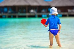 Adorable girl playing with beach toys during Royalty Free Stock Photography
