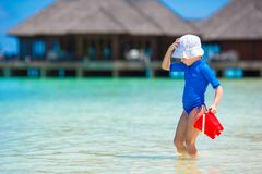 Adorable girl playing with beach toys during. Adorable little girl playing with beach toys during summer vacation Royalty Free Stock Photography