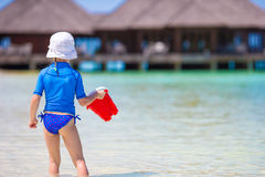 Adorable girl playing with beach toys during Royalty Free Stock Image