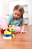 Adorable girl playing with blocks Royalty Free Stock Photos