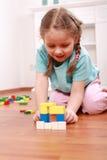 Adorable girl playing with blocks stock photos