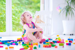 Adorable girl playing with blocks Stock Images
