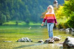 Free Adorable Girl Playing By Konigssee Lake In Germany On Warm Summer Day. Cute Child Having Fun Feeding Ducks And Throwing Stones Int Royalty Free Stock Photography - 113305157