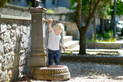 Adorable girl playing with drinking water fountain Stock Photography