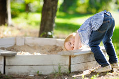 Adorable girl playing in a sandbox Royalty Free Stock Photos