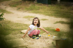Adorable girl playing with toys in a sand Stock Photo