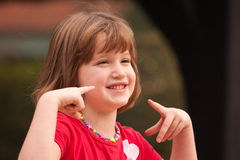 Adorable Girl Poses While Playing Royalty Free Stock Photography