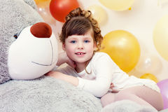 Adorable girl posing lying on teddy bear Stock Photos