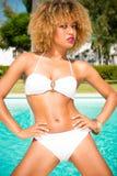 Adorable Girl Posing in White Bikini Stock Images