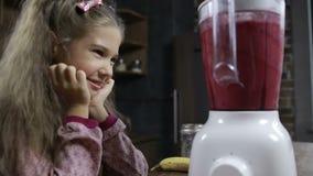 Adorable girl preparing fresh smoothie in blender stock video footage