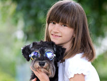 Adorable girl and puppy Stock Photos