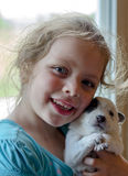 Adorable girl with puppy closeup Royalty Free Stock Images