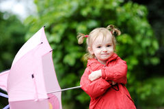 Adorable girl at rainy day in autumn Royalty Free Stock Photo