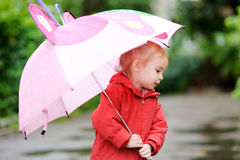 Adorable girl at rainy day in autumn Stock Photography