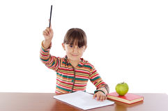 Adorable girl raising her hand Royalty Free Stock Images
