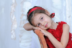 Adorable girl in red dress Royalty Free Stock Photos