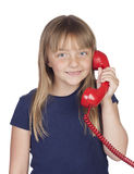 Adorable girl with a red phone Royalty Free Stock Photography